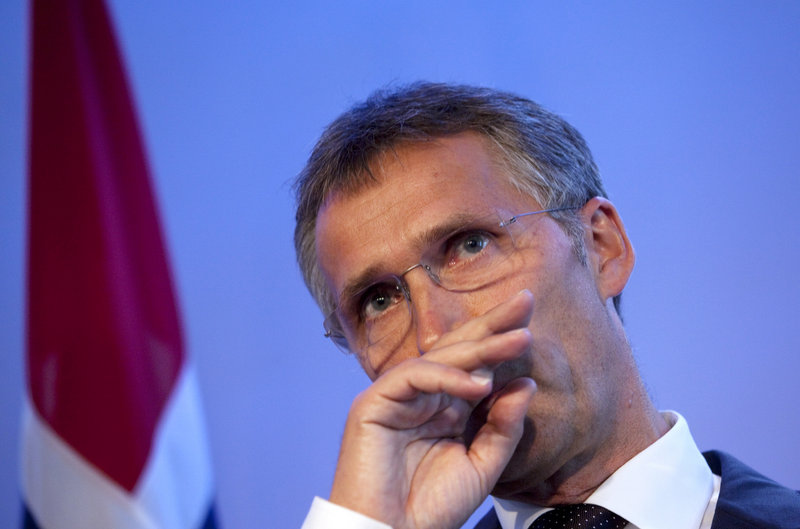 "Norway's Prime Minister Jens Stoltenberg attends a news conference in Oslo on Wednesday. He said the response to violence is ""more democracy, more openness."""
