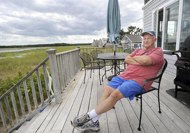"""Goose Rocks Beach homeowner Bob Almeder, a retired professor, is one of 24 plaintiffs suing the town of Kennebunkport for trying to expand public beach access. """"We all knew when we bought our properties that our deeds were down to the low-water line,"""" he said."""