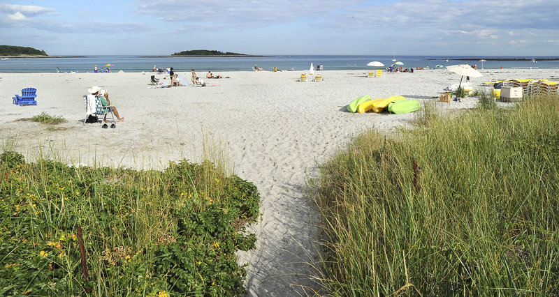 A small public path leads to a small section of public beach at Goose Rocks Beach in Kennebunkport.