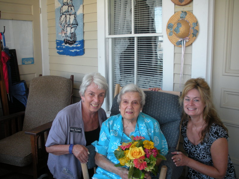 Irene Bennett, center, owner of Bennett's Guest House in York, celebrated her 102nd birthday July 28 with friends including Liaison Elaine Burnham, left, of the Greater York Region Chamber of Commerce, and Business Manager Holly Roberts.