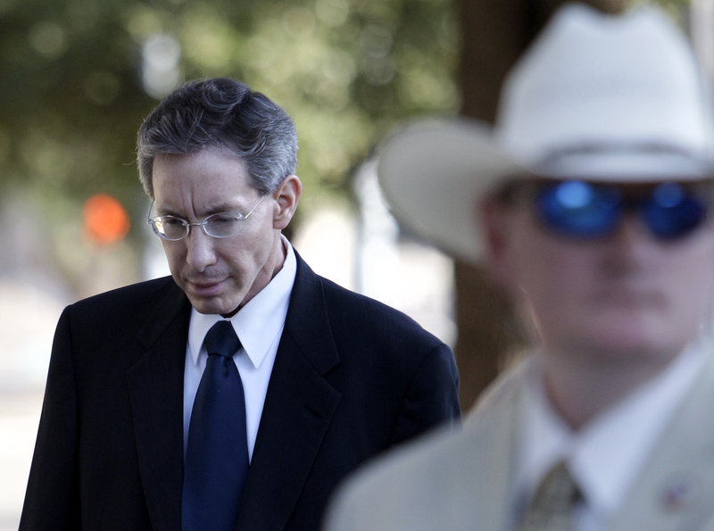 Polygamist sect leader Warren Jeffs arrives Thursday at the Tom Green County Courthouse in San Angelo, Texas. Jeffs' much-anticipated sexual assault trial began Thursday.