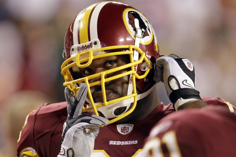 Albert Haynesworth was in Redskins Coach Mike Shanahan's doghouse all of last season, but some of his new Patriots teammates say they expect him to fit in just fine.