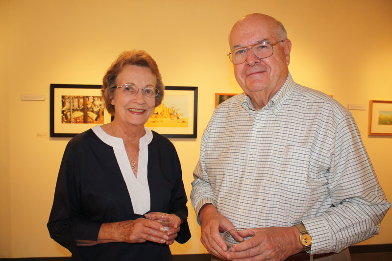 Doris McAfee and her husband, Robert McAfee, M.D., a University of New England trustee emeritus. They plan to bring their grandchildren to UNE s Art Gallery to see the Children s Book Illustrators show when they visit. We still have all the books at home, Robert McAfee said.