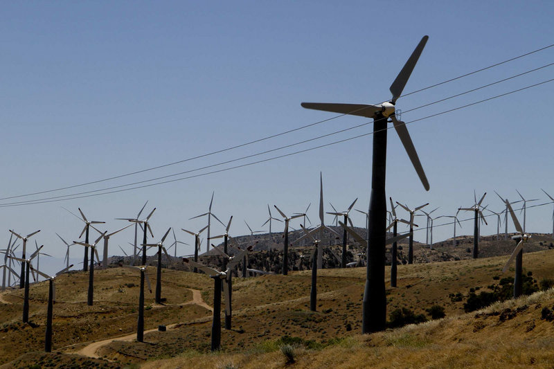 Wind turbines are seen in operation in the Tehachapi Pass near Tehachapi, Calif.