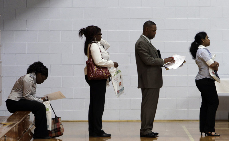 Job seekers wait in line at an employment fair in Southfield, Mich., in June. Two years after economists declared the end of the recession, the recovery is the weakest since the 1930s. Unemployment remains at 9.2 percent and consumers remain wary.