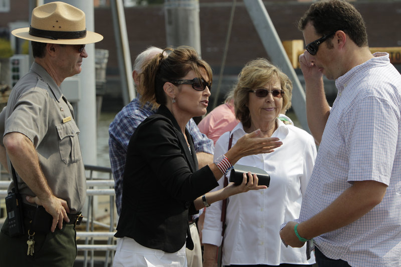Forward, feminists: Sarah Palin (above, shown visiting the Statue of Liberty in June) and Rep. Michele Bachmann (below, on the campaign trail) are far removed from traditional feminists in their political views.