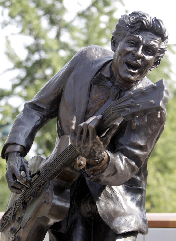A bronze statue of legendary musician Chuck Berry is seen at the dedication attended by Berry on Friday in University City, Mo. The statue of the St. Louis native was dedicated near Blueberry Hill, the University City club where the octogenarian still performs monthly.