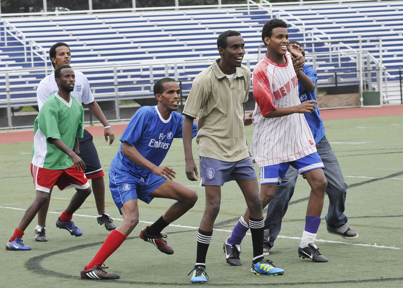 Players jockey for position prior to their games as the southern Maine Somali community plays soccer in support of Somalia on Friday.