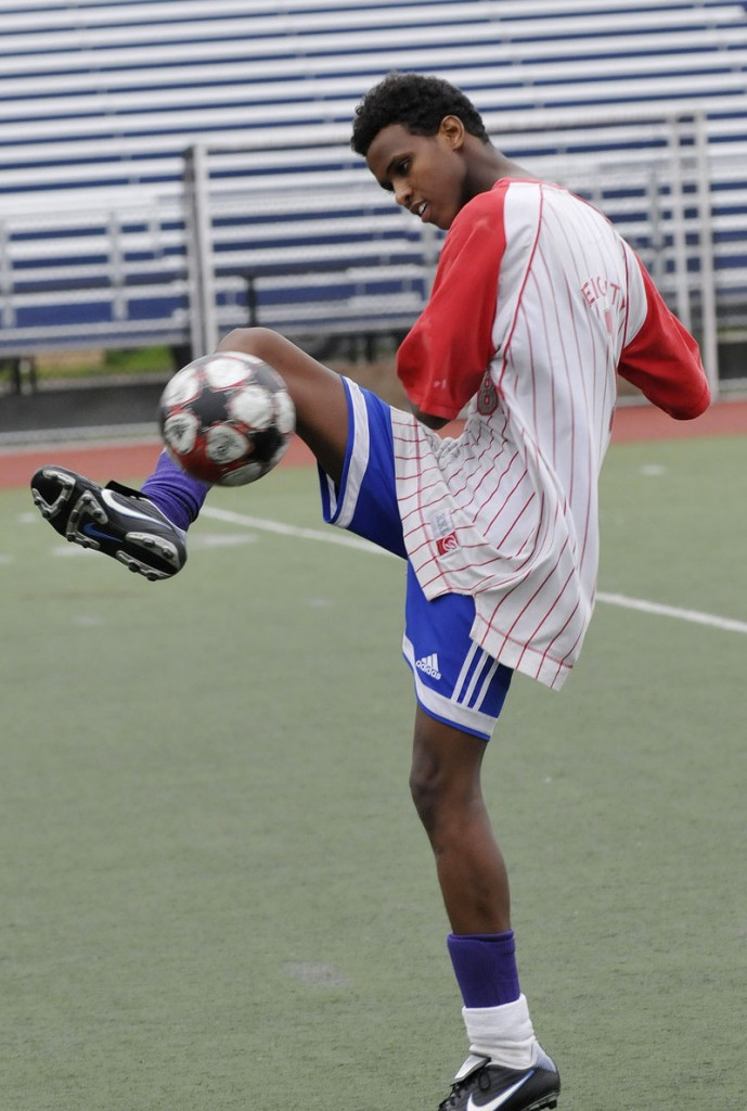 Sadam Sharit, 19, of Portland kicks the ball around before the games Friday.