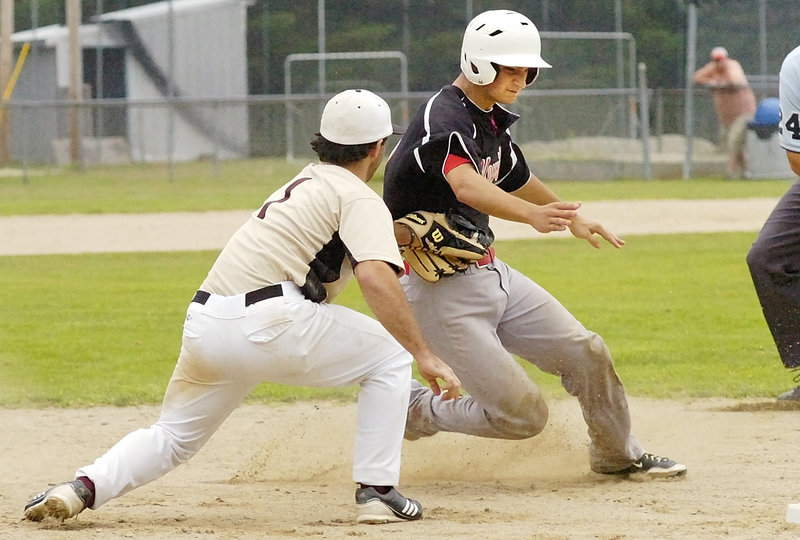 Third baseman Eric White of Brewer tags out Adam Helmke of Morrill Post, who was attempting to stretch a double into a triple during Brewer's 8-3 victory Friday.