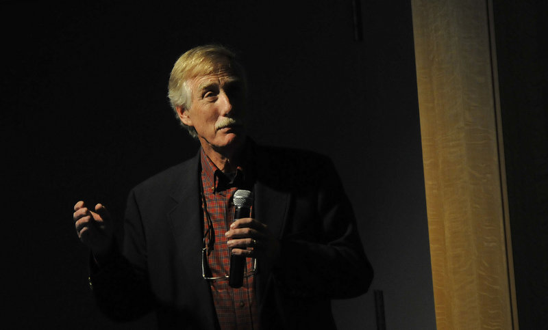 Former Gov. Angus King speaks at the Portland Public Library on Friday to promote