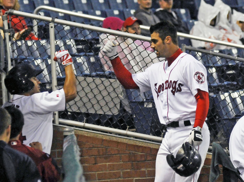 Mark Wagner of the Sea Dogs gets congratulations as he reaches the dugout after hitting a home run in the fourth inning that gave Portland a 3-0 lead. Wagner also had an RBI double as the Sea Dogs beat Altoona 6-2 Friday night.