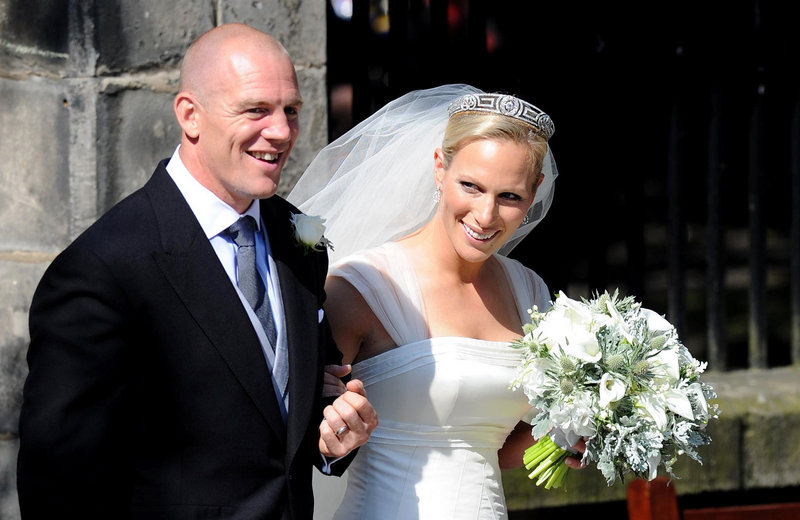 Rugby player Mike Tindall and Zara Phillips emerge from Canongate Kirk in Edinburgh after their wedding Saturday.