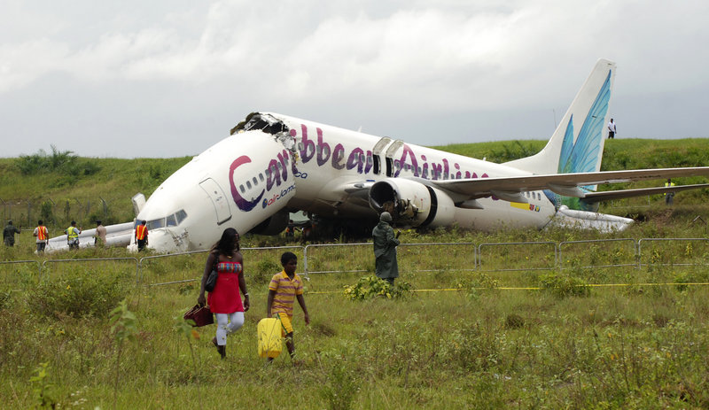 The broken fuselage of a Caribbean Airlines Boeing 737-800 is seen after it crashed at the end of the runway at Cheddi Jagan International Airport in Timehri, Guyana, on Saturday.