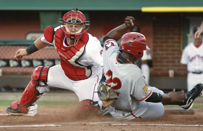 Portland catcher Tim Federowicz applies the tag but doesn't have the ball, which got past him, allowing Altoona's Quincy Latimore to score in the fourth inning of the Curve's 5-1 victory Saturday night at Hadlock Field.