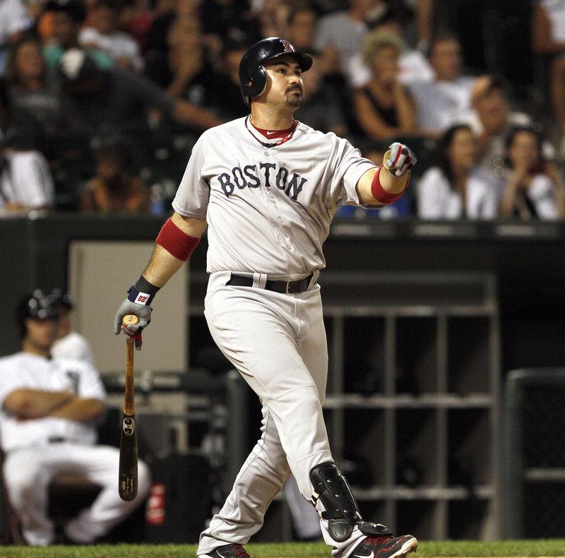 Adrian Gonzalez of the Boston Red Sox watches the flight of the ball Saturday night as it leaves the park in the ninth inning of the 10-2 victory against the Chicago White Sox.