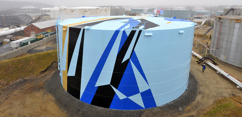 One of the oil tanks at the Sprague Energy farm is painted to the specifications furnished by Jaime Gili of London, the winning artist of the Art All Around competition.