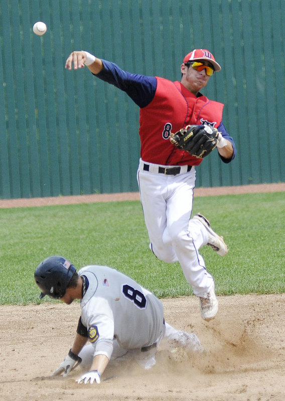 Adam Pexton of Whitestown, N.Y., tries to turn a double play as Bedford's Matthew Woodmansee slides into second during Monday's championship game.