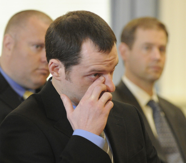 Jason Twardus wipes away a tear as a family member speaks for him before he is sentenced to 38 years for the murder of Kelly Gorham in 2007.