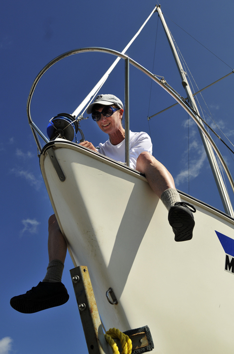 Karen Packard of Westbrook works on her 25-foot sailboat, Room 25, today after she and her husband, Brian Peterson, pulled the boat in at East End Beach in preparation for Hurricane Irene.