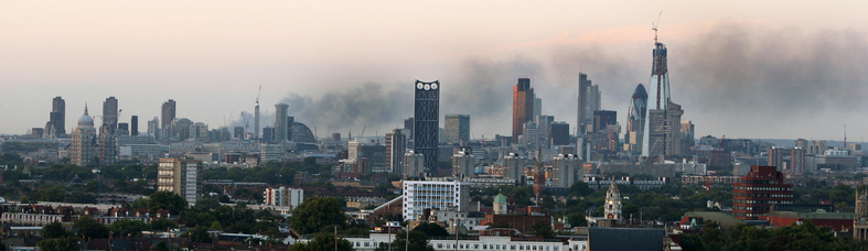 A view of the London skyline Tuesday evening shows smoke still billowing from a Sony warehouse in Enfield, north London, after rioting in the area the previous night. A beefed-up police presence helped to quiet the capital, but unrest spread to central and northern England on a fourth night of violence, vandalism and widespread looting.