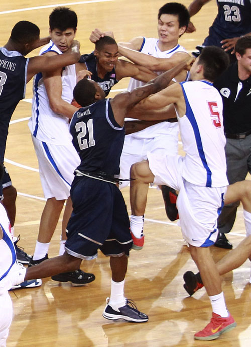Players of the Georgetown University men's basketball team and China's Bayi Rockets fight during their exhibition game in Beijing on Thursday. The bench-clearing brawl at the exhibition game between American and Chinese basketball teams marred the orchestrated harmony of U.S. Vice President Joe Biden's visit to China. The fight forced the game to end early.