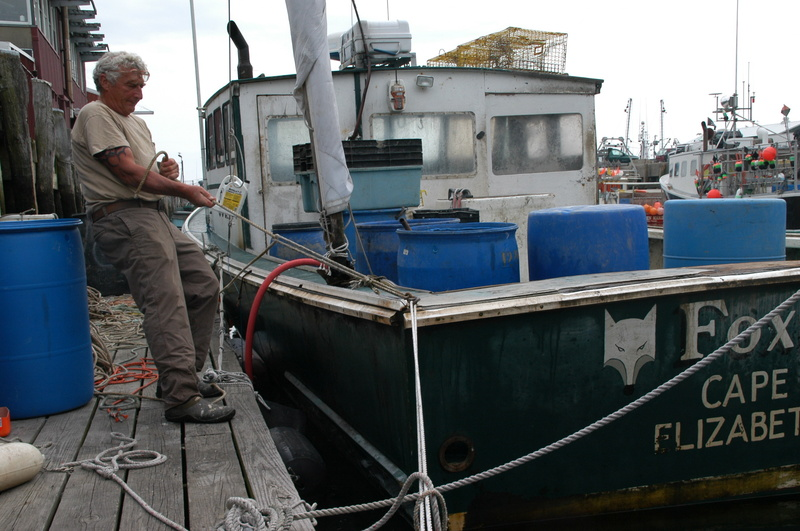Anticipating high winds from Hurricane Irene, lobsterman Skip Werner ties fast his 40-foot lobster boat Foxie Lady to a dock on Union Wharf in Portland on Saturday. The storm was on track to hit Maine on Sunday.