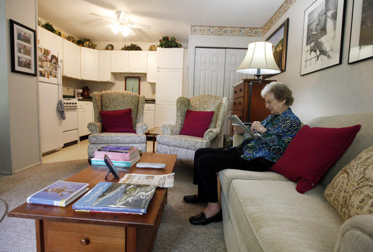 Jane Merrill as she works a crossword puzzle in her apartment in the home of her son, William Merrill, in Carmel, Ind. The Merrill family had their two-car garage renovated to create a mother-in-law suite for Jane.