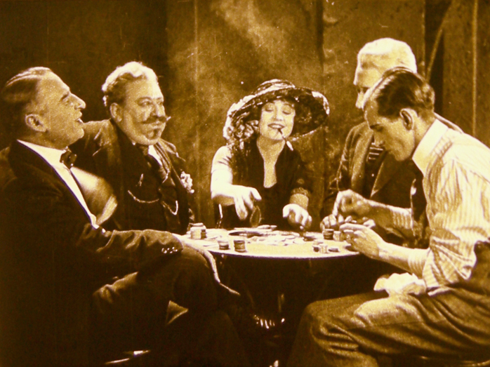 In this image released by the National Film Preservation Foundation, Betty Compson, center, is shown in a scene from