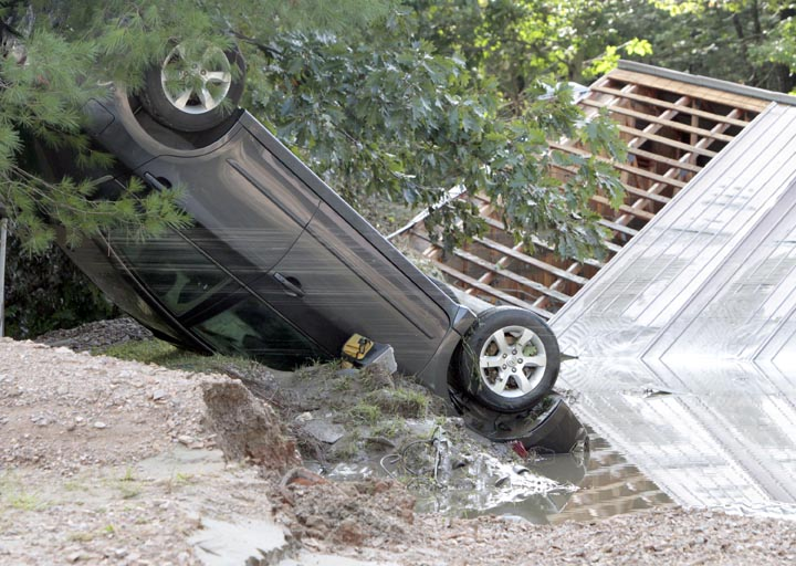 A car lies upside down today in the aftermath of Tropical Storm Irene in Waterbury, Vt.