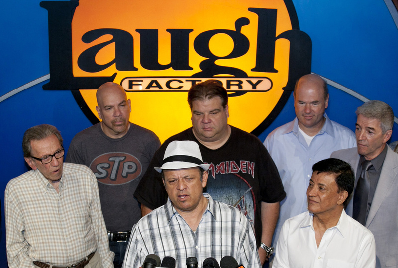 Comedian Paul Rodriguez, at podium, expresses the comedians' support Friday for Jerry Lewis to be reinstated as host of the annual Muscular Dystrophy Association Telethon. With him are, from left, Norm Crosby, Jason Stuart, Angelo Tsarouchas, Larry Miller, Jamie Masada (front) and Tom Dreesen.