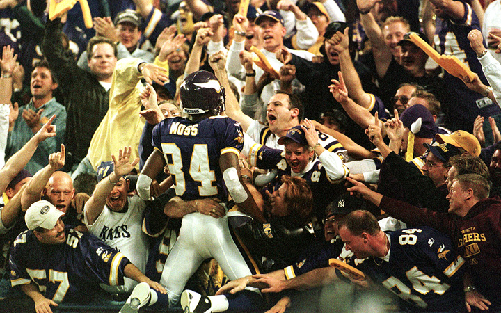 In this Oct. 9, 2000, photo Minnesota Vikings wide receiver Randy Moss (84) jumps into the crowd to celebrate his 42-yard touchdown pass from Daunte Culpepper against the Tampa Bay Buccaneers.