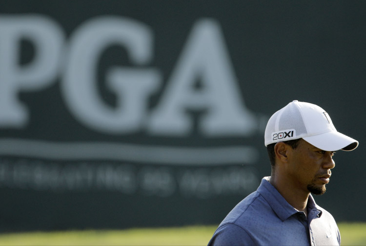 Tiger Woods waits to finish on the 18th green during the second round of the PGA Championship golf tournament on Friday at the Atlanta Athletic Club in Johns Creek, Ga.
