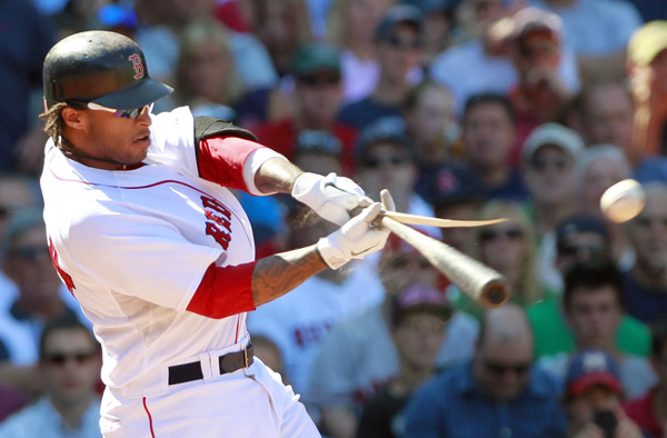 Boston Red Sox's Darnell McDonald cracks his bat on a fly out to left field in the fourth inning of a baseball game against the Tampa Bay Rays in Boston on Wednesday.