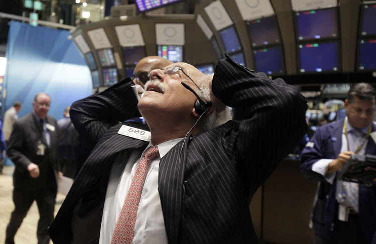 Trader Peter Tuchman reacts to the action on the floor of the New York Stock Exchange today.