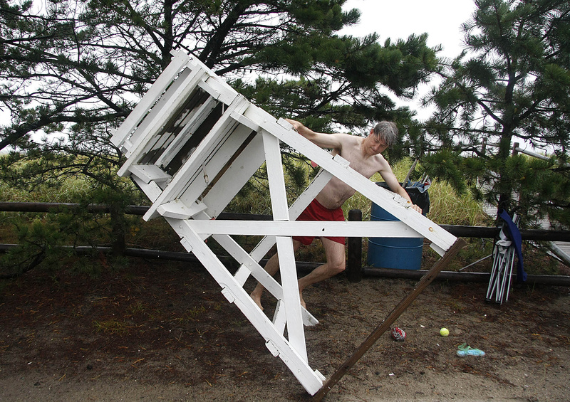 Steve Opre, a lifeguard with the Ferry Beach Park Association, secures a lifeguard stand alongside Surf Street in Camp Ellis this morning. Opre, along with fellow lifeguards Kate Campbell Strauss and Eli Grober, took a swim to test the waters and closed the beach after determining it unsafe.