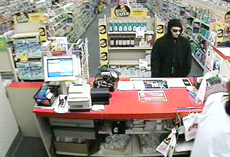 A security camera image of the man who robbed the CVS pharmacy at Pine Tree Shopping Center.