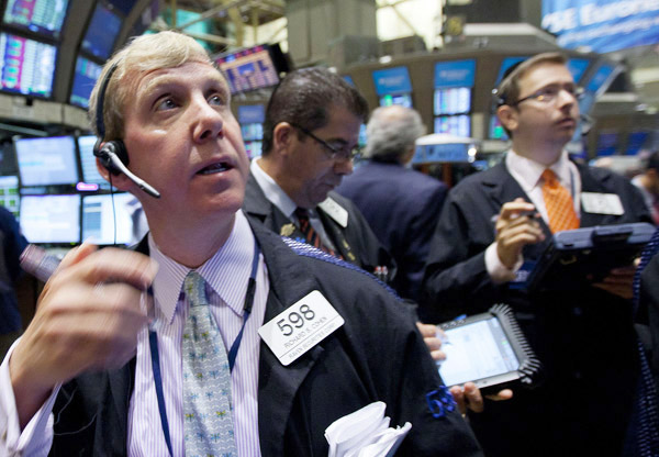Traders monitor the action on the floor of the New York Stock Exchange today.