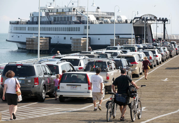 Passengers with cars and bicycles prepare to board a ferry departing Martha's Vineyard today. The Steamship Authority, which operates ferries between the island and the mainland, has added additional vessels to the schedule in anticipation of the arrival of Hurricane Irene.