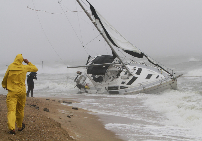 A stranded sailboat founders in the surf along the Willoughby Spit area of Norfolk, Va., as Hurricane Irene hits Norfolk, Va., today. The live-aboard couple attempted to outrun the storm and got caught up in the high surf and wind. They were rescued by local fire and rescue personnel.