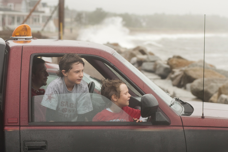 Cameron and Christian Schaffer, 10 and 7 of Saco check out the waves from inside the family truck at high tide during Tropical Storm Irene along Surf Street in Camp Ellis, Saco, today. Shortly before a wave sprayed the brothers inside the window.