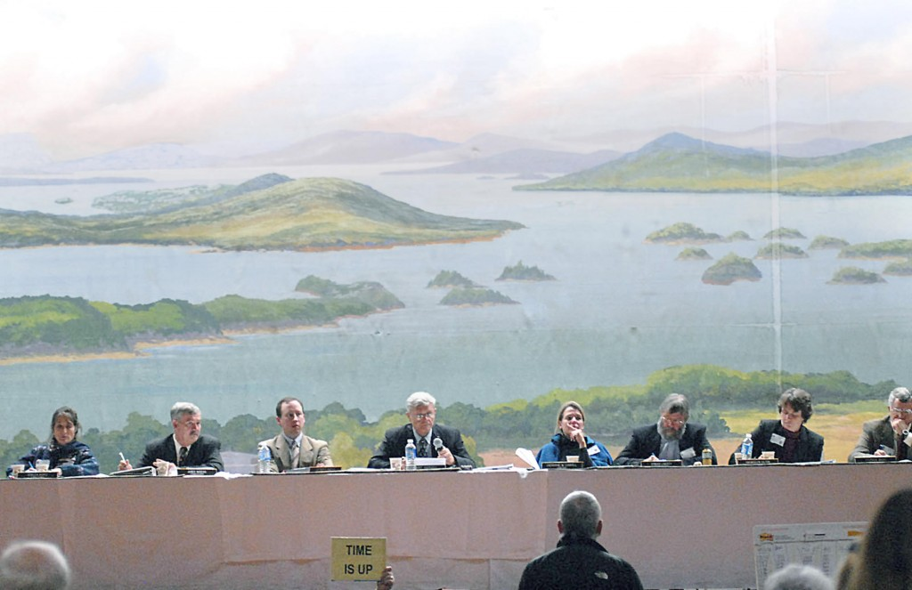 The Land Use Regulation Commission listens to a speaker during a public hearing on the proposed concept plan for Plum Creek's lands in the Moosehead Lake Region in 2007. A plan to eliminate the commission and give its work to county governments is far too drastic.
