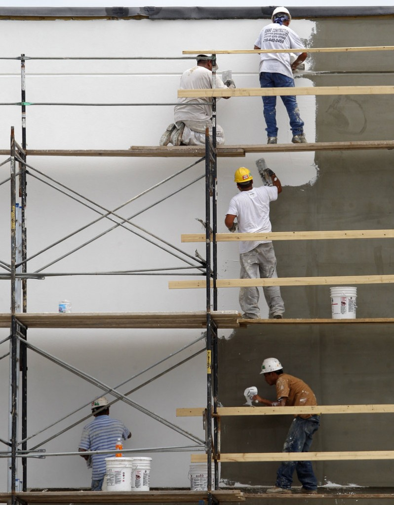 Workers resurface the exterior of a store at a shopping plaza in Mayfield Heights, Ohio. Construction spending rose in July but remains at half the pace considered healthy by most economists.