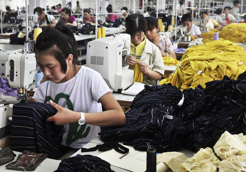 Factory workers stitch bamboo-fabric clothing in China's Shandong province. Sluggish U.S. growth has hurt exporters of Chinese products.