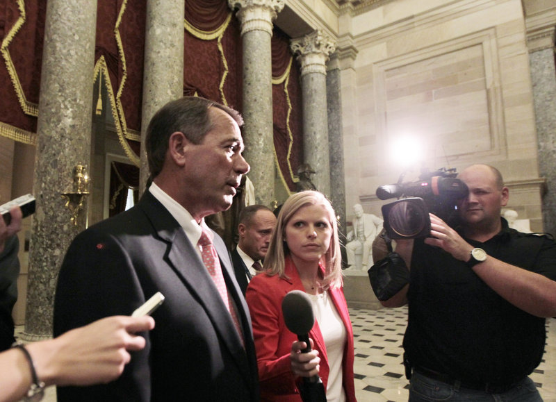 House Speaker John Boehner, R-Ohio, returns to his office after emergency legislation to avert a government default and cut federal spending passed a showdown vote in the House of Representatives in Washington on Monday.