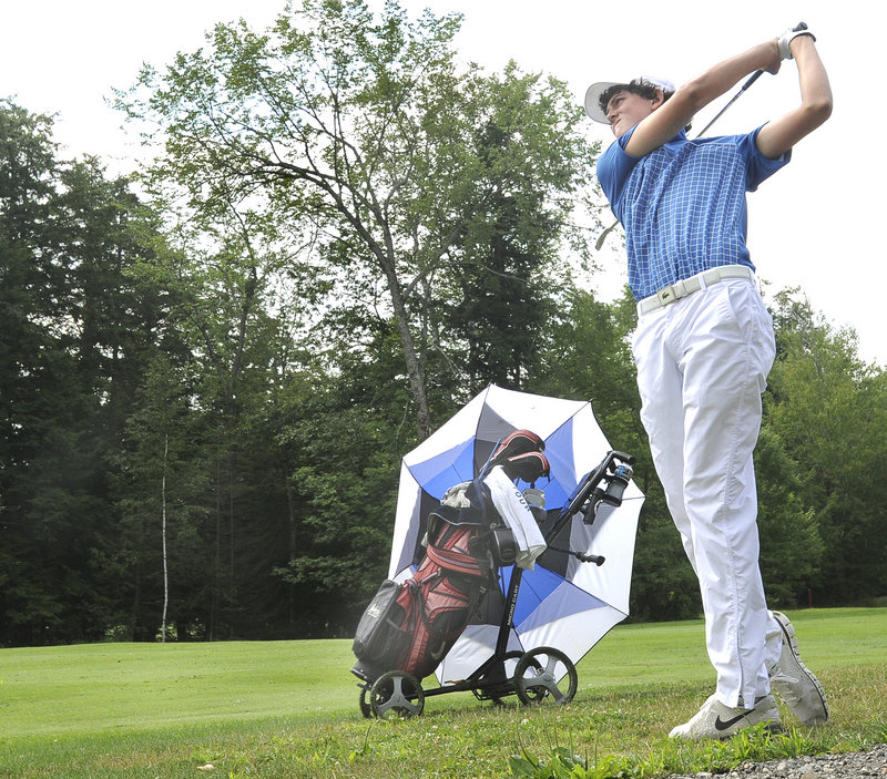 Austen Truslow hits from the short rough on the ninth hole Tuesday in the Maine Junior Amateur at Val Halla Golf Course. Truslow, who's from Florida and summers in Islesboro, shot a 1-under 71 for the first-round lead.