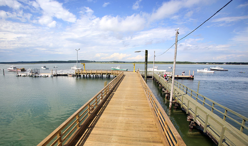 Pine Point's new wooden pier is 14 feet wide and 220 feet long.