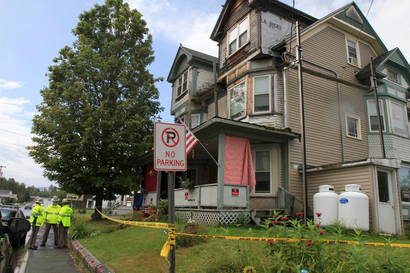 Police guard the home of Celina Cass in Stewartstown, N.H., on Tuesday. Divers recovered the 11-year-old's body from the Connecticut River, a quarter-mile from her home, on Monday. She had been missing since July 25.