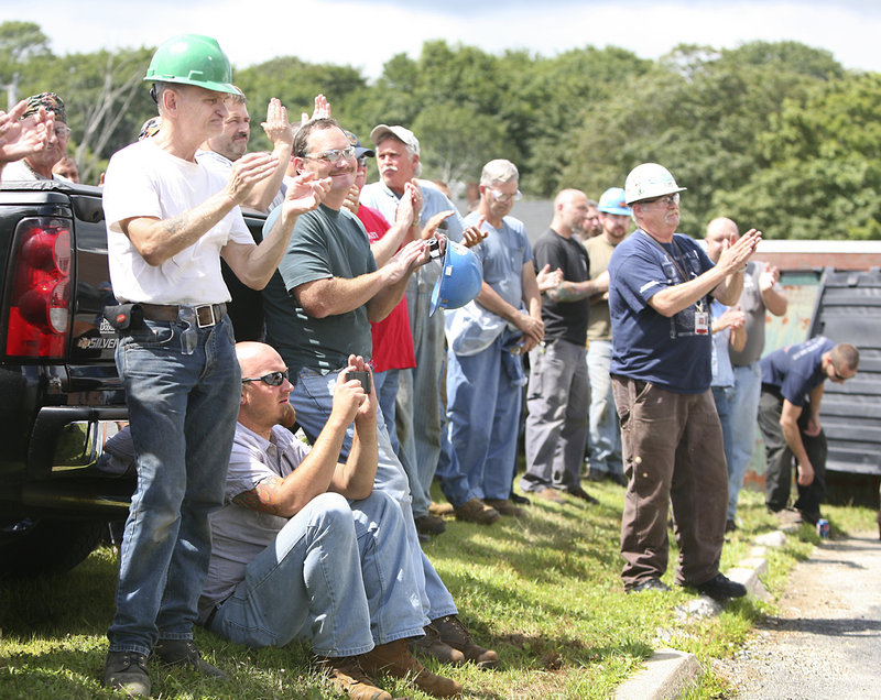 BIW workers applaud Sen. Susan Collins during her remarks Wednesday outside the Bath shipyard. BIW, which is owned by General Dynamics, has a work force of about 5,300.