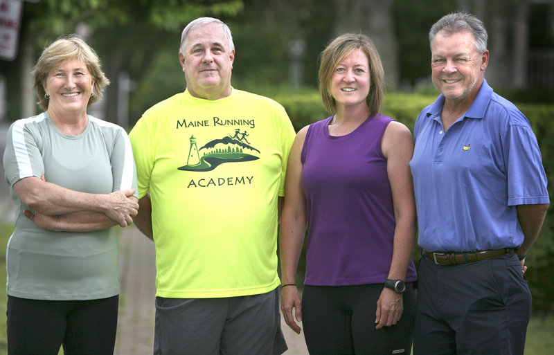 Susan Kimball, left, and Peter King, right, trained for the Beach to Beacon under a program that includes coaches Roger Morse, second left, and Kathy Bowe, second right.